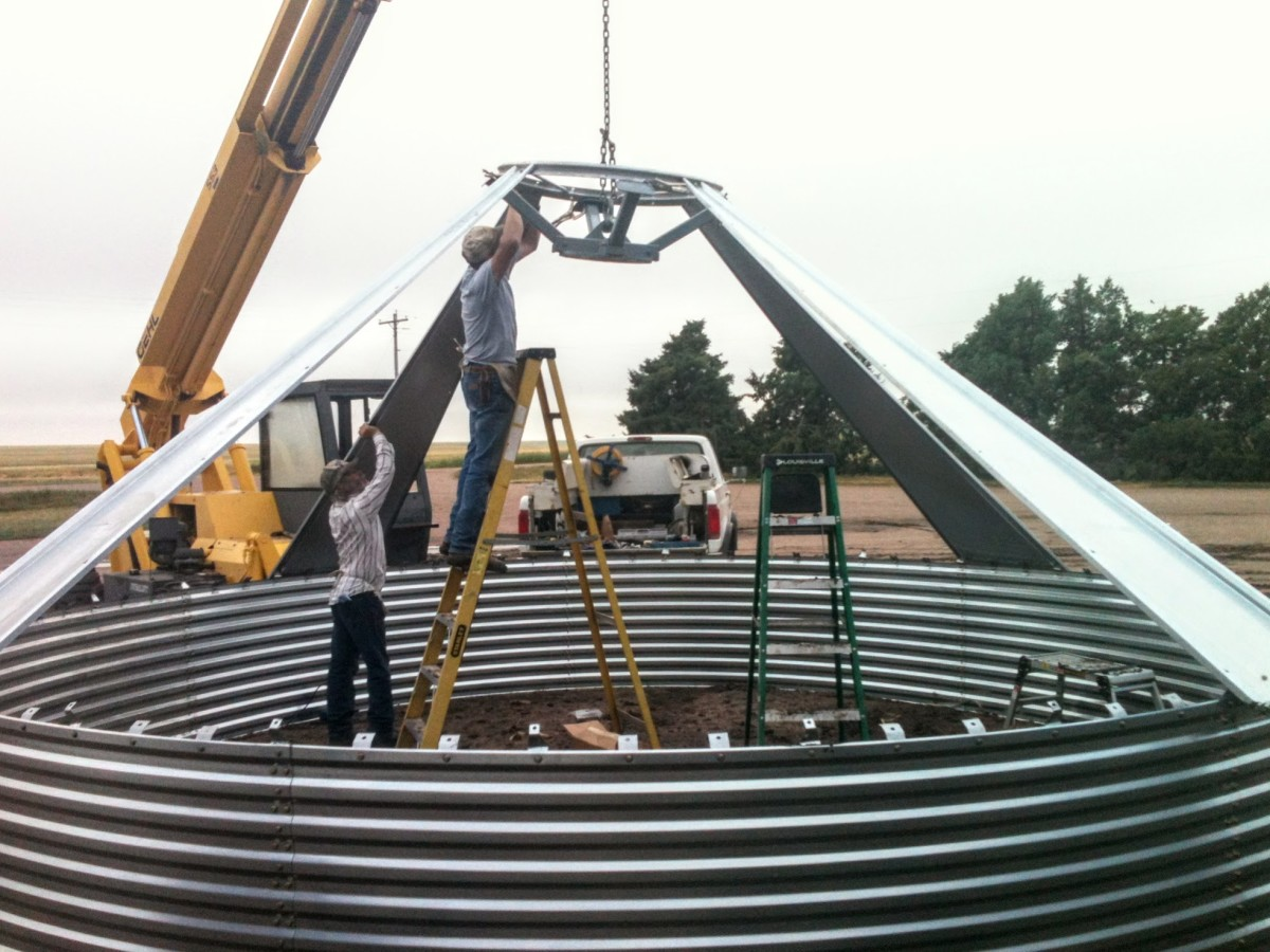 Grain bin roofs are fragile while being built, though surprisingly strong once completed.