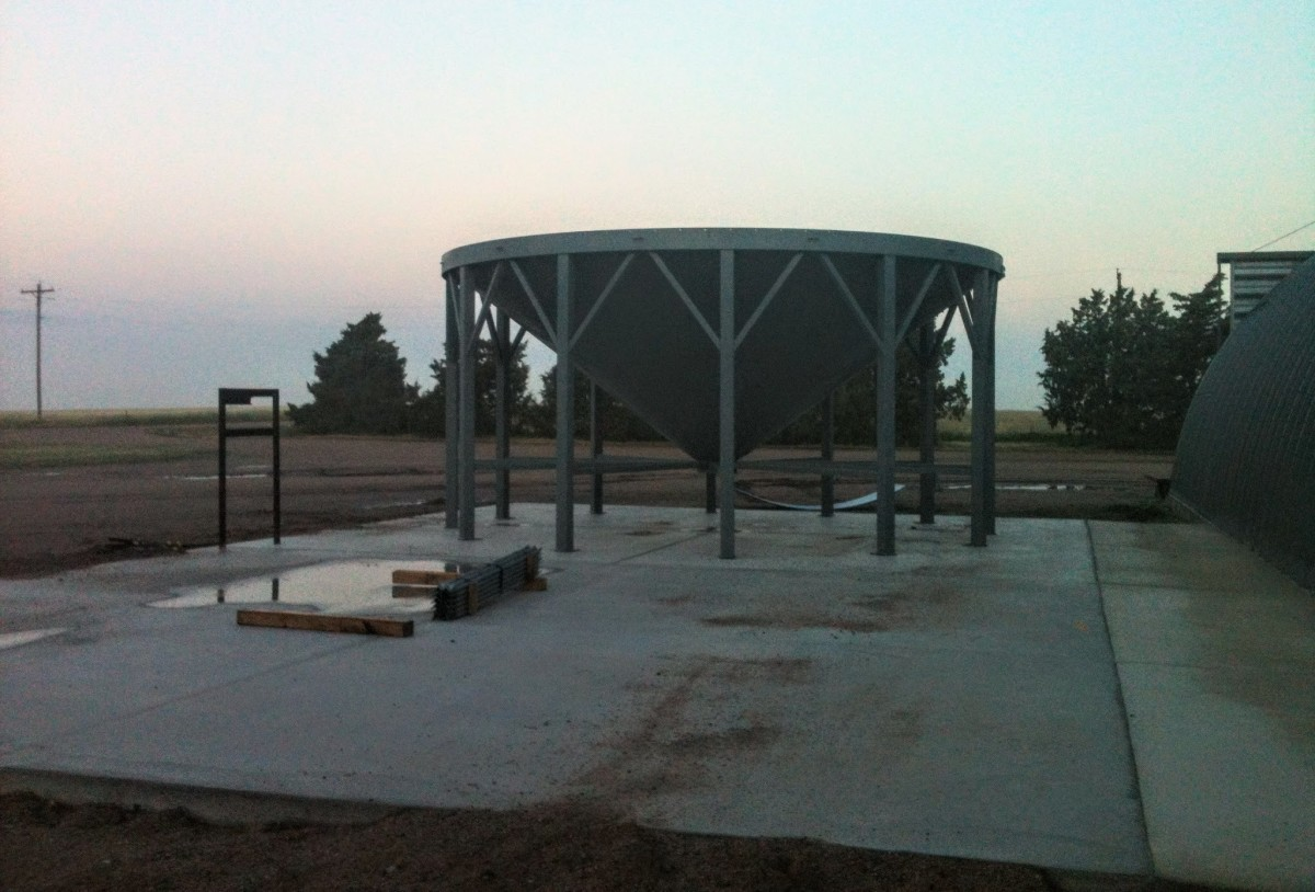 This pad has been carefully worked and cured in order to properly bear the weight of a full grain bin. The site was scraped, leveled, and filled with builders sand to provide a proper base.