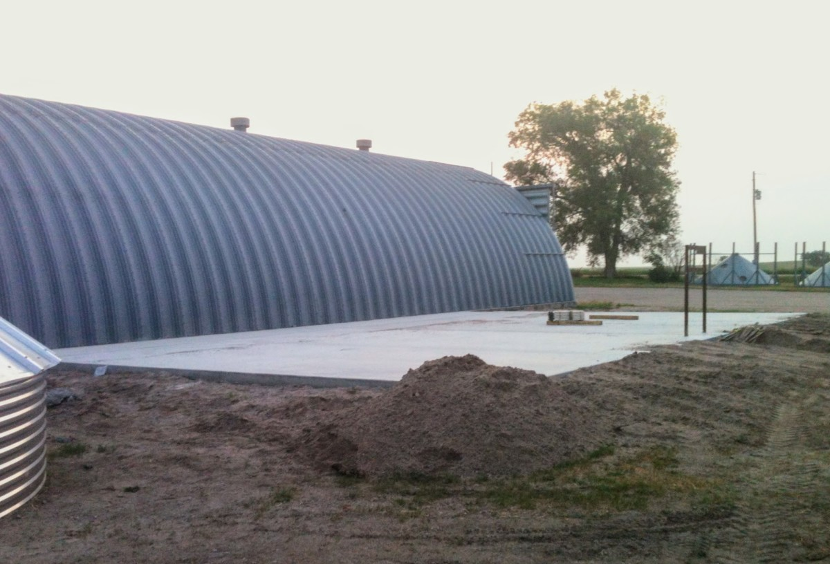 A 6 sack mix is as light a concrete mix as is recommended for grain bin foundations. A stronger mix would be better, along with plenty of reinforcement.