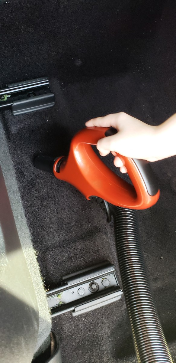 My son helping me clean the car. The top handle detaches for close up cleaning.