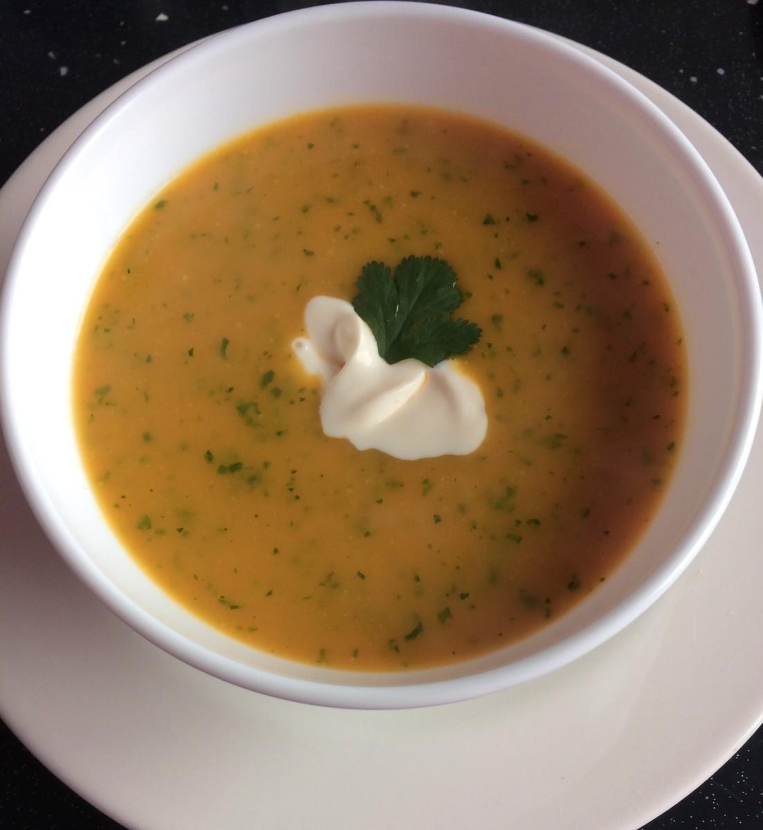 Pumpkin soup with fresh coriander and crème fraîche.