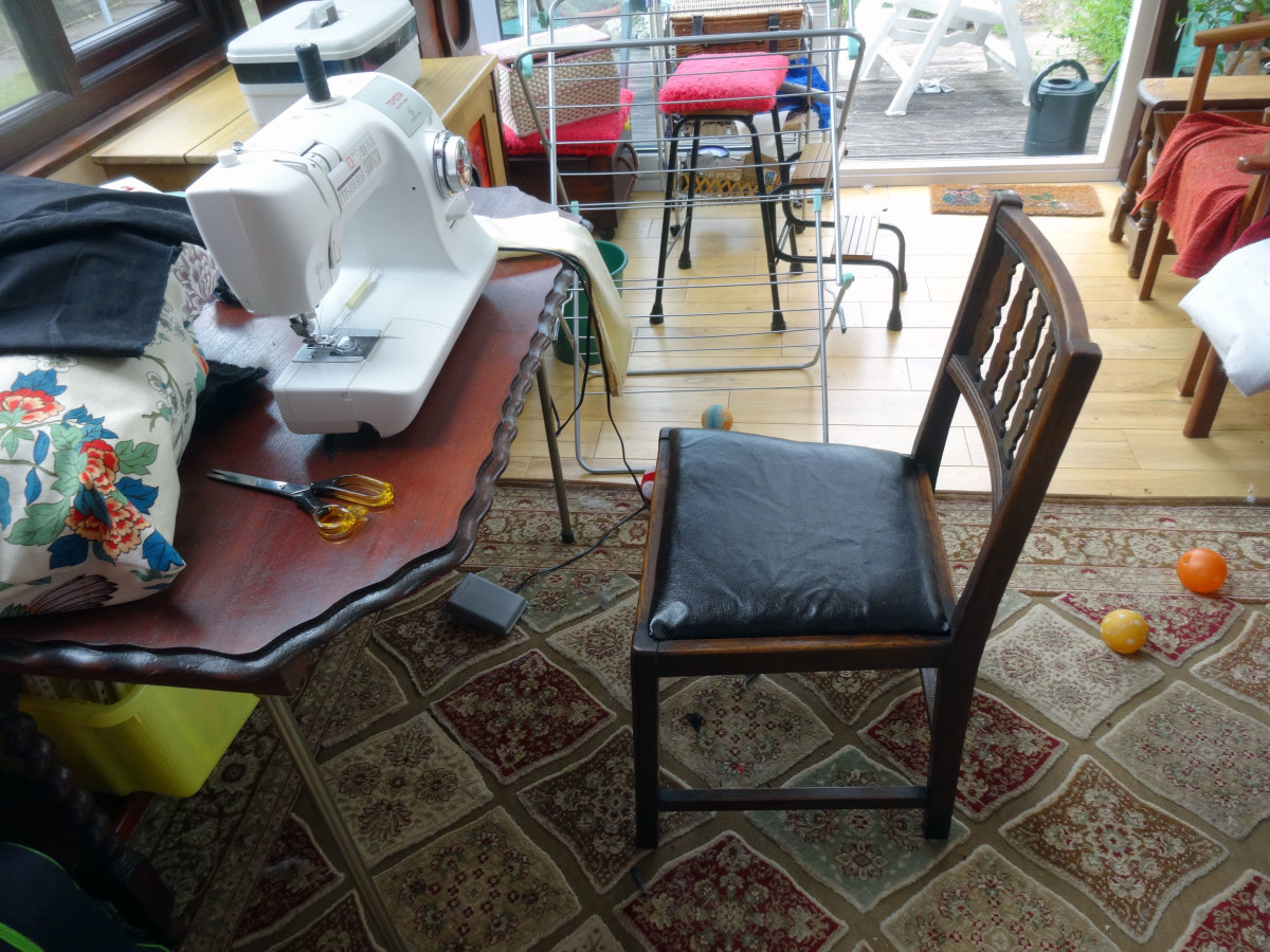 One of the renovated and reupholstered chairs put back in the conservatory for use as my wife's sewing chair.