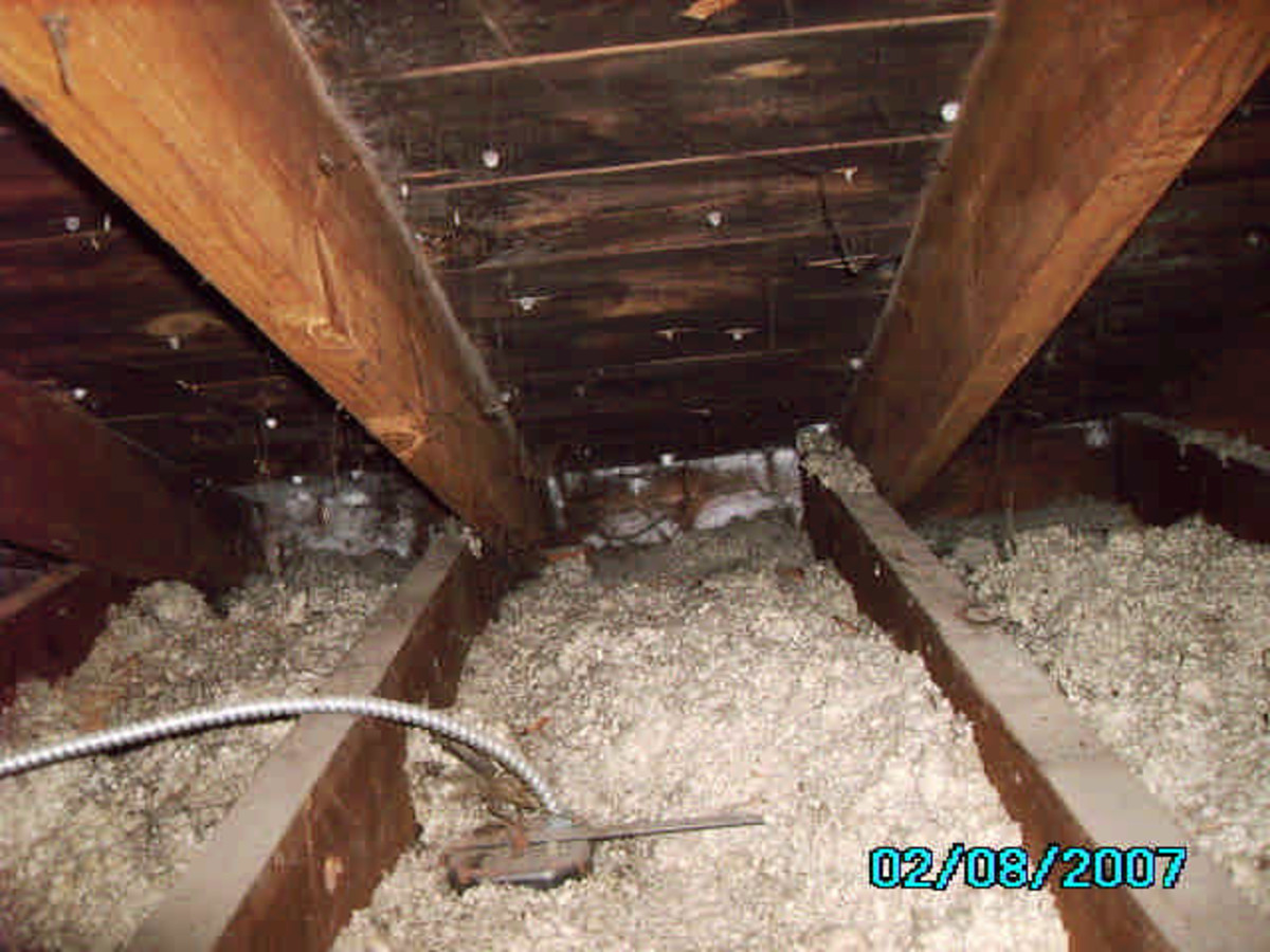 Black mold and frost on roof decking and roofing nails caused by inadequate ventilation