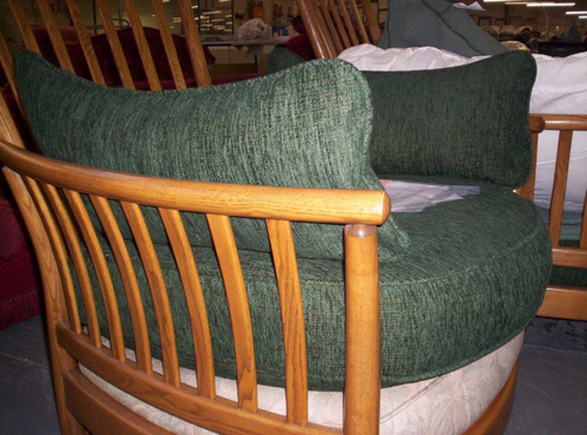 Upholstered furniture with wooden arms