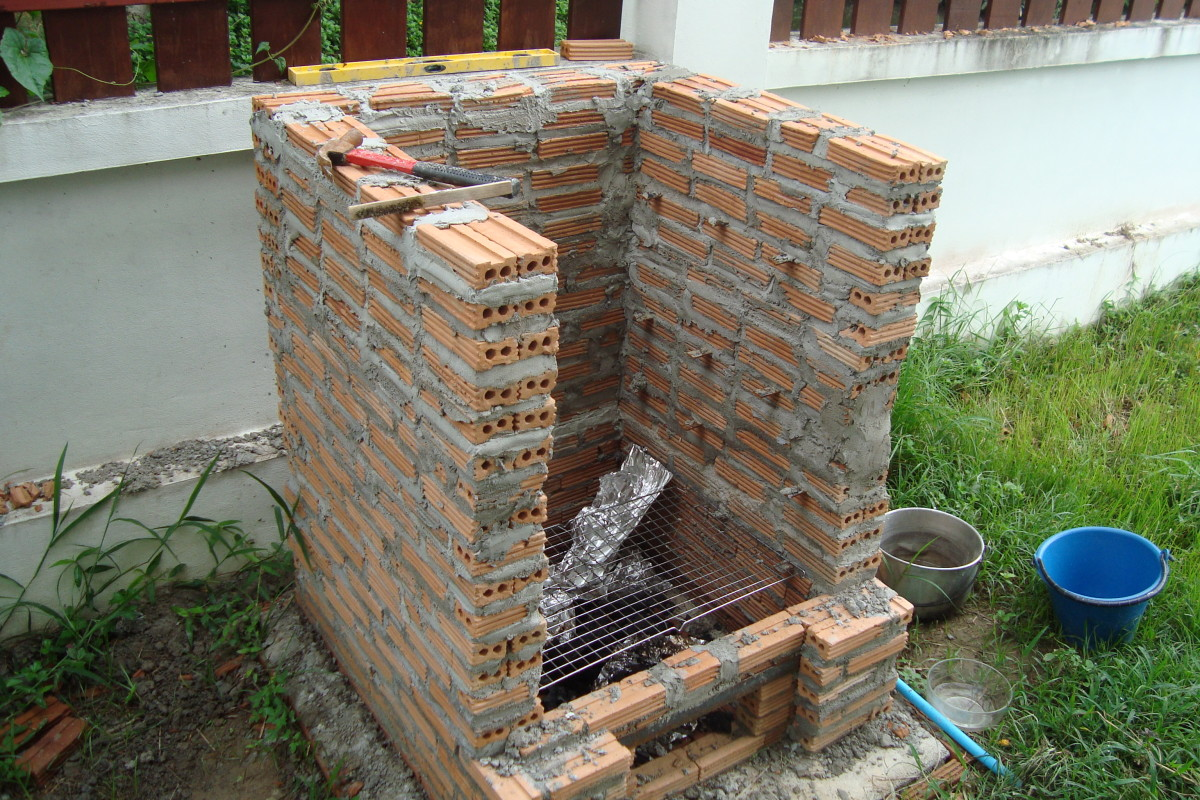 Note the gap I left for the gas burner and the angle iron that bridges the gap (click on the pic to see it larger). You can see I actually only have one course of bricks at the very front - which seems to work OK.