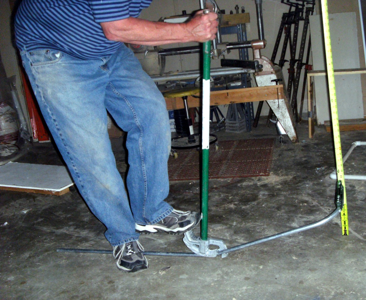 "Putting the ""kick"" into a kick 90.  Note the tape measure being used to measure the amount of kick"