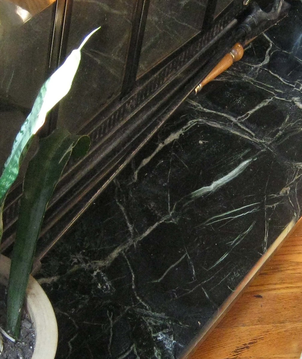 Salvaged Marble from Old Store as Hearth Stone