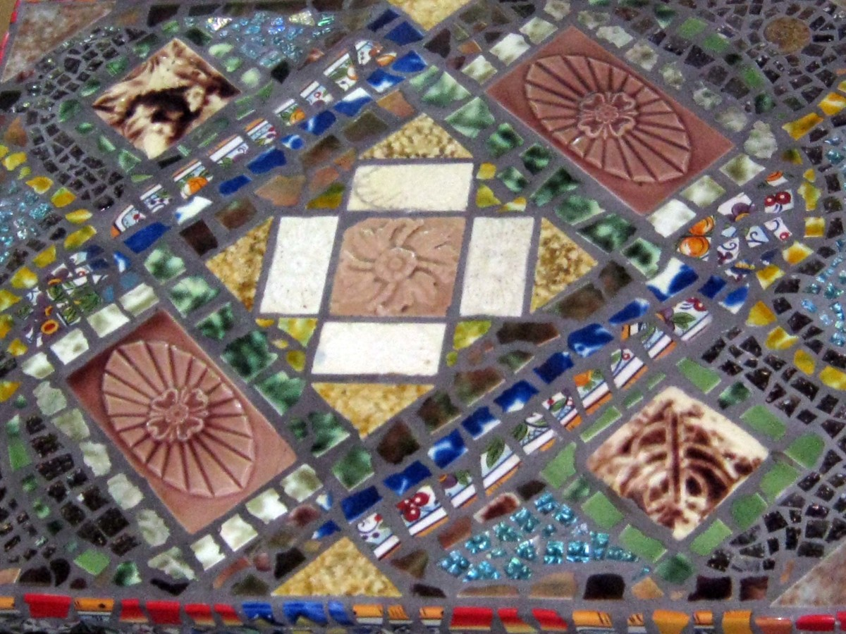 My friend Leola made this mosaic table top using old tiles.