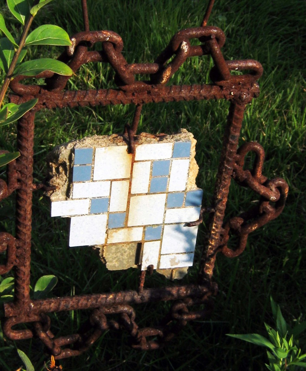 """""""Junk art"""" with rusty metal chain and tile flooring."""