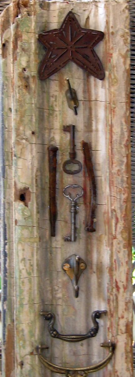 Old woodwork decorated with salvaged hardware.