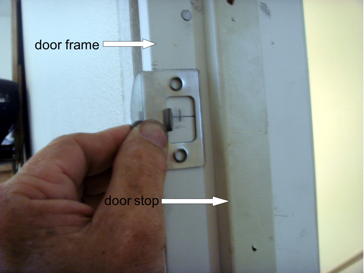 Tracing the latch for chisel work.  The door stop is shown here.