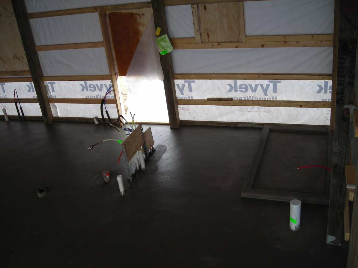 When the concrete floor was poured we had a shower basin poured and formed so we could feel the warmth of the radiant in floor heat underfoot.