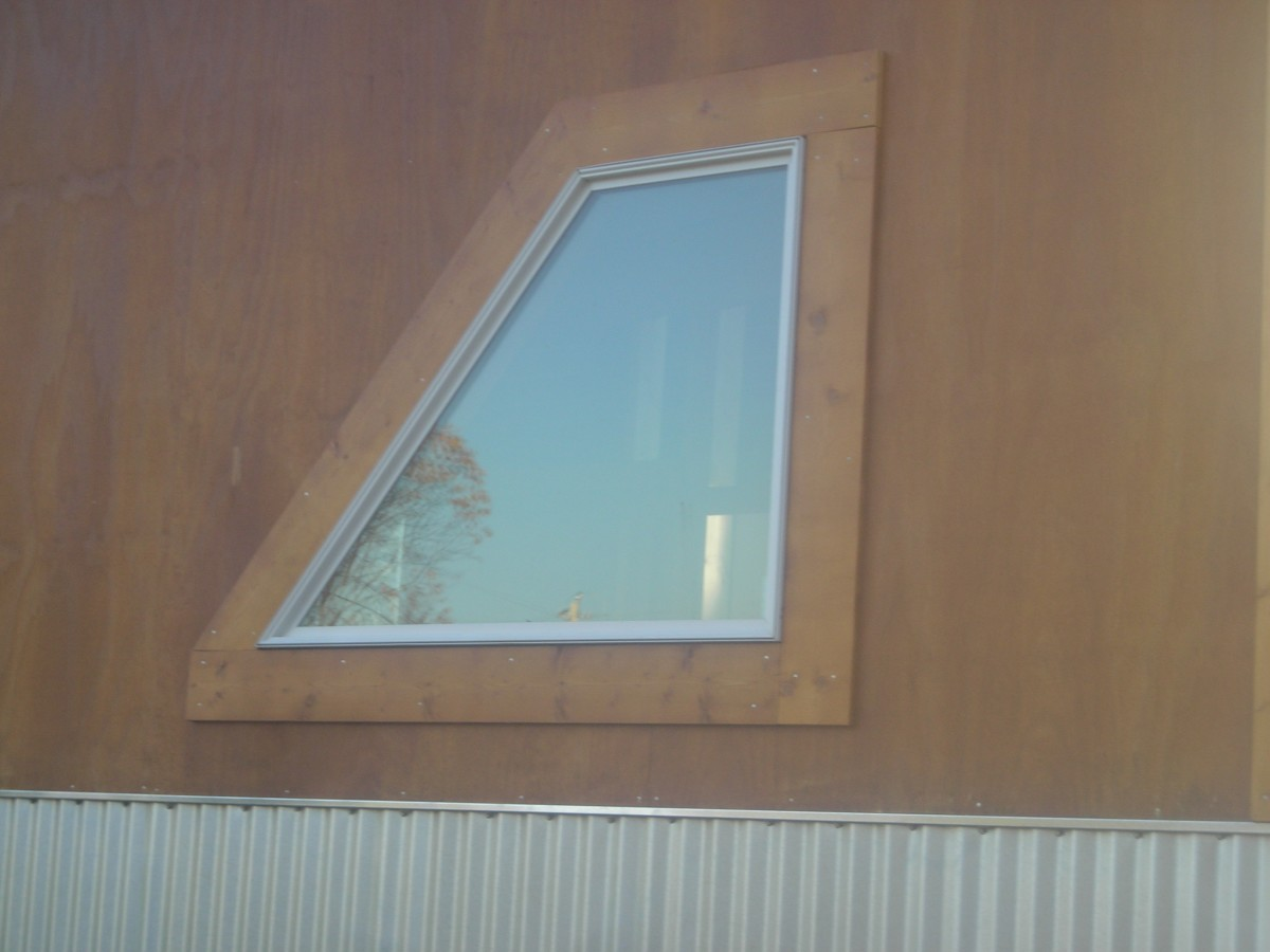 Pole barn house salvaged window.