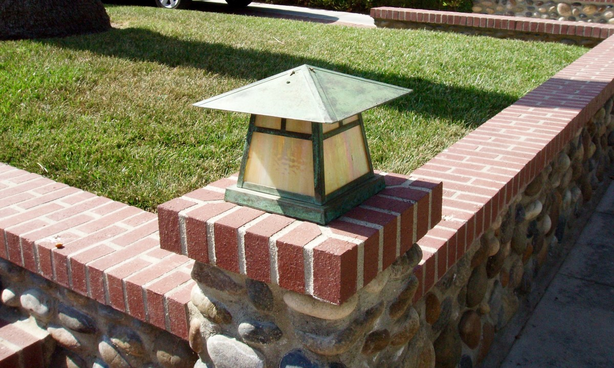 All three of these features are hardscape: the metal lantern, the brick toppers, and the stone wall.
