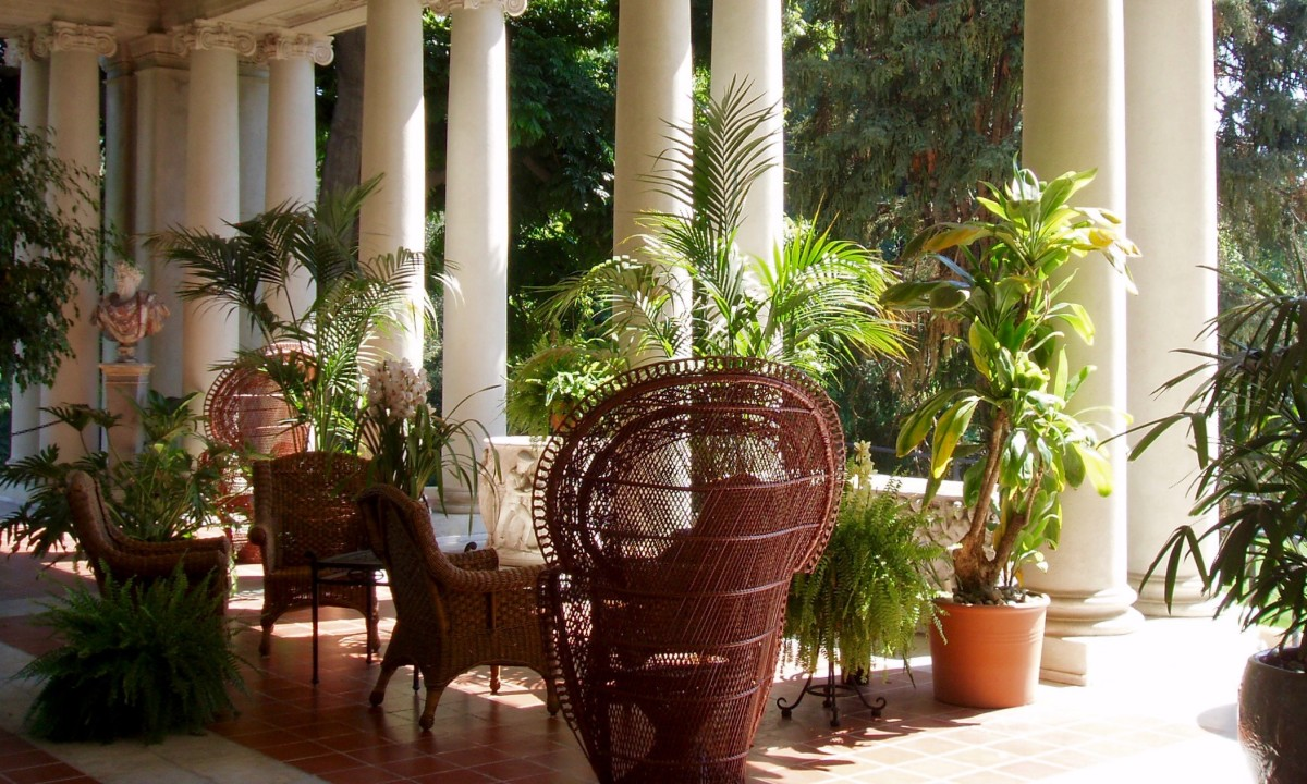 Outdoor patio at the Huntington Gardens in Pasadena, California. Your patio doesn't have to have fancy columns to feel decorative and graceful. The right patio furniture and potted plants will do, supported by a nice tile, stone, or wood floor.