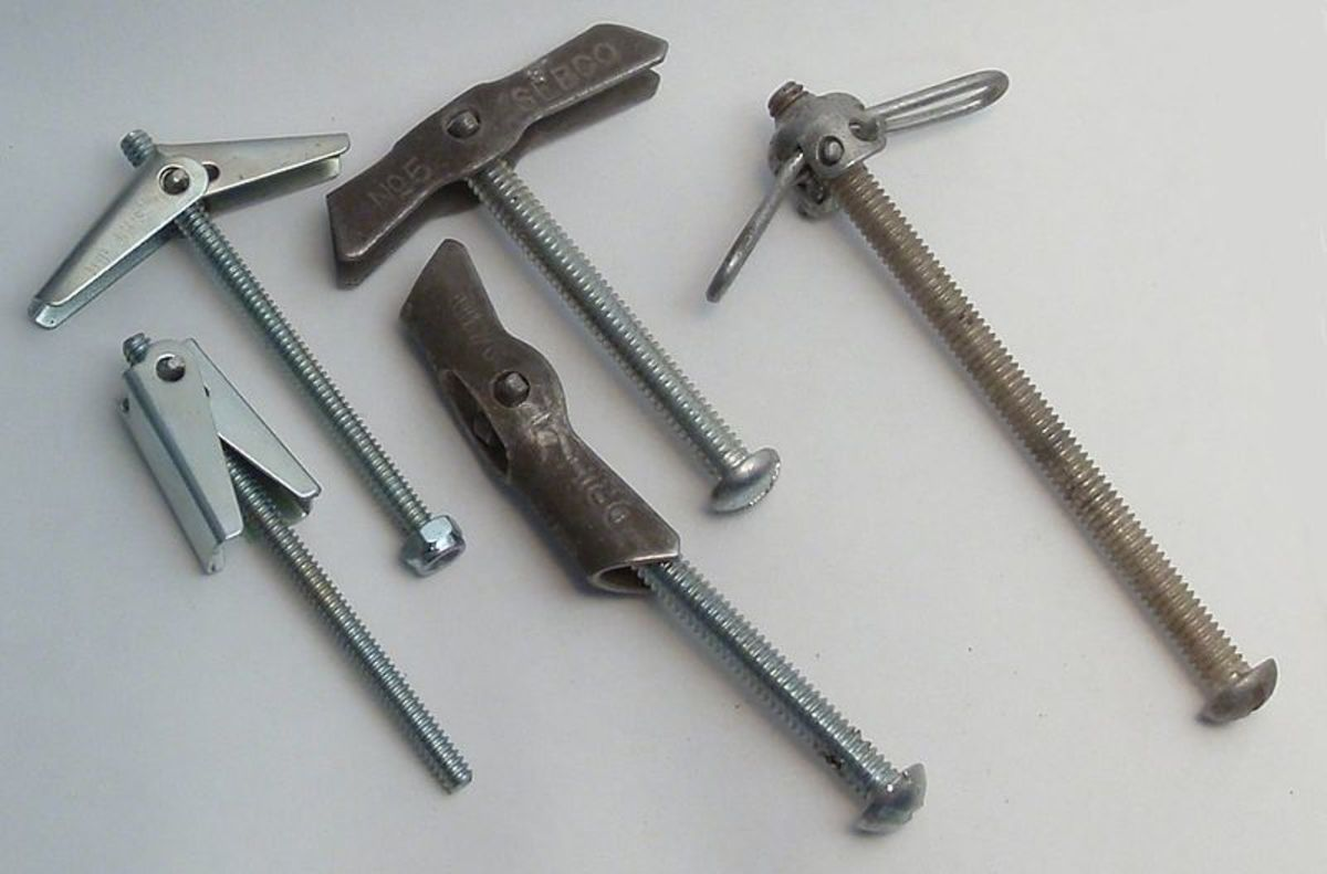 Spring toggle anchors