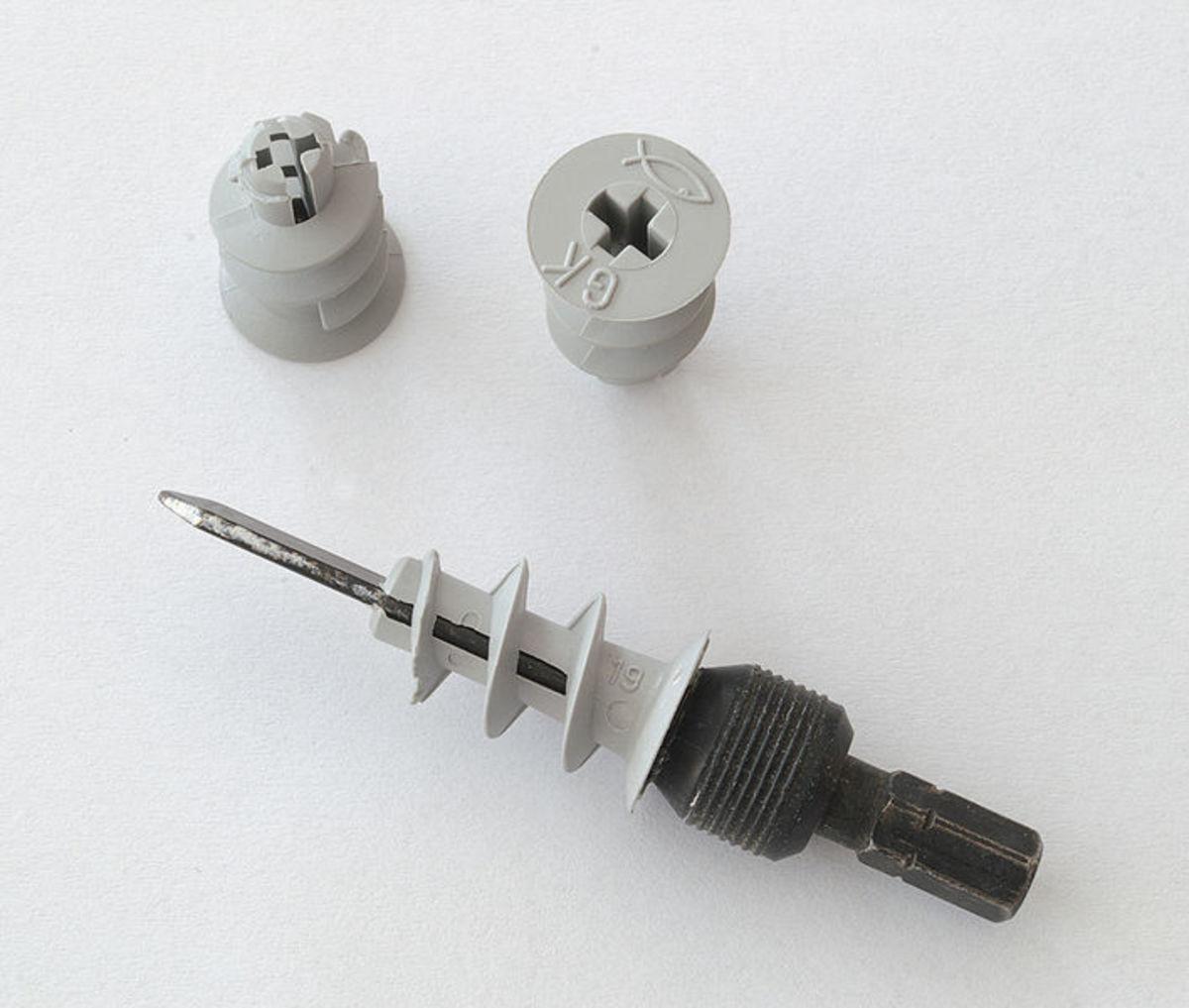 Self-drive drywall anchors and drive bit for cordless drill. Metal versions are also available. The pilot hole size which needs to be drilled in the plasterboard (6mm), is marked on the fixing