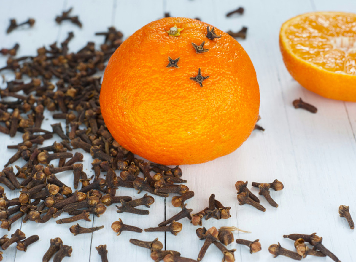 A simple orange, cloves, some spices, and a ribbon is all you need to make your very own moth repellant.