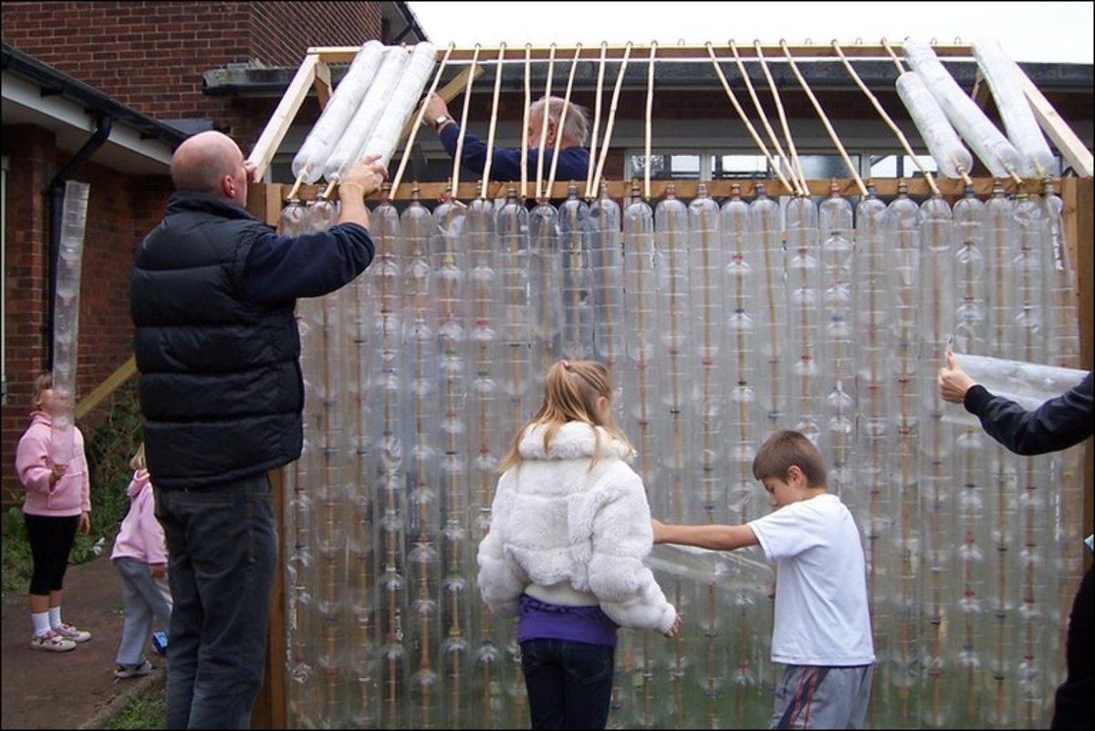 the roof is put on the plastic bottle greenhouse