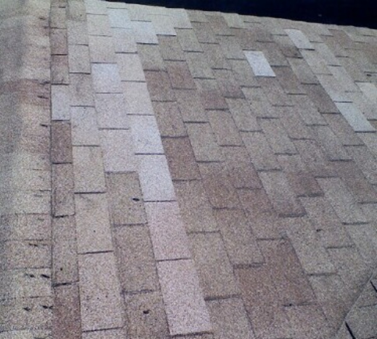 Finished repair job.  The new shingles are slightly lighter in color, not being weathered yet, but it is not objectionable.