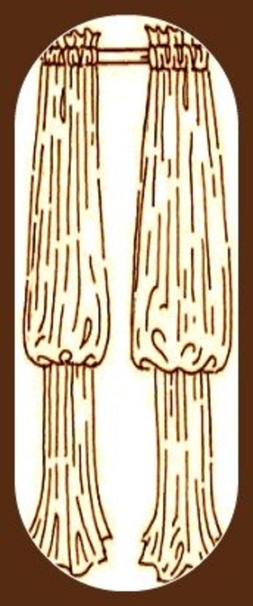 One 'pouf' bishop sleeve drapes