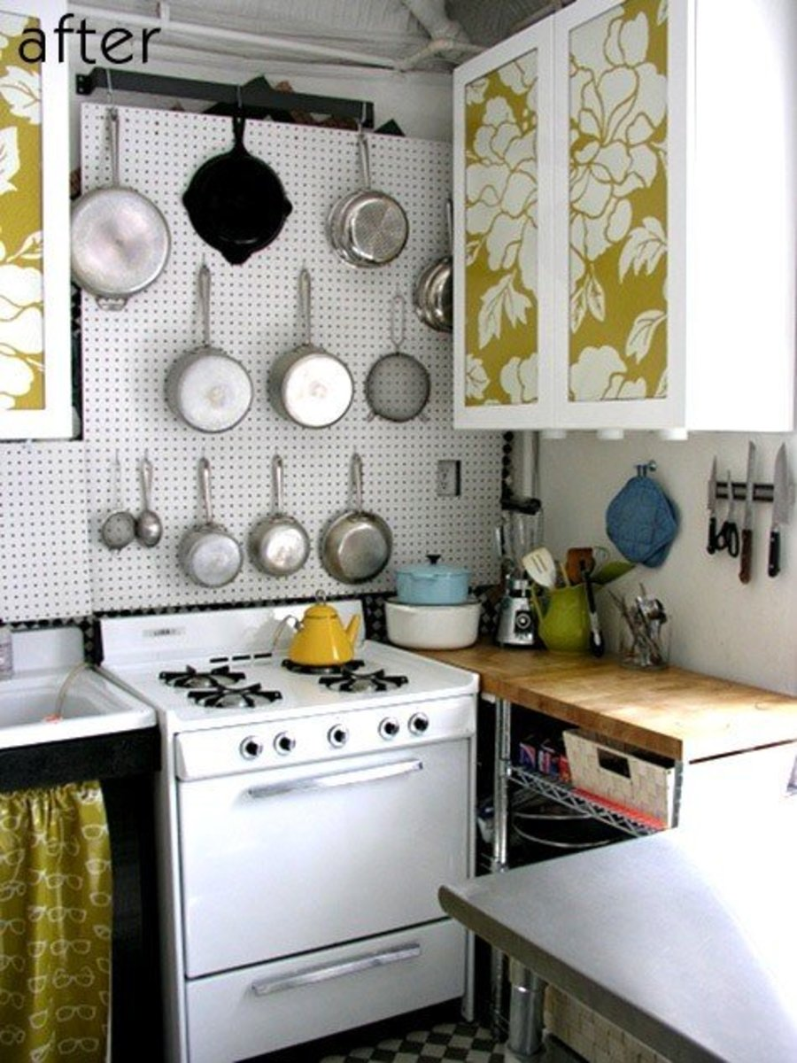 Installing the peg board over the stove is a great space-saving option for this smaller kitchen.