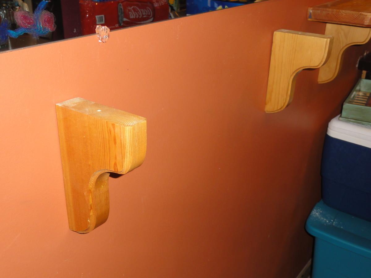 Make sure the brackets feel snug once you slide them onto the screws.