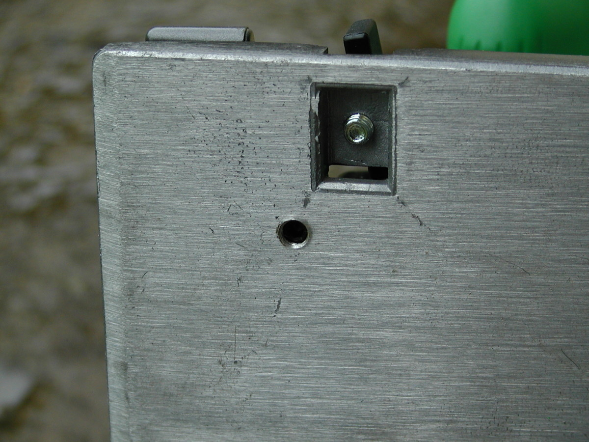 Adjustment grub screw in base. This adjusts the stop to ensure 90 degree setting is square.