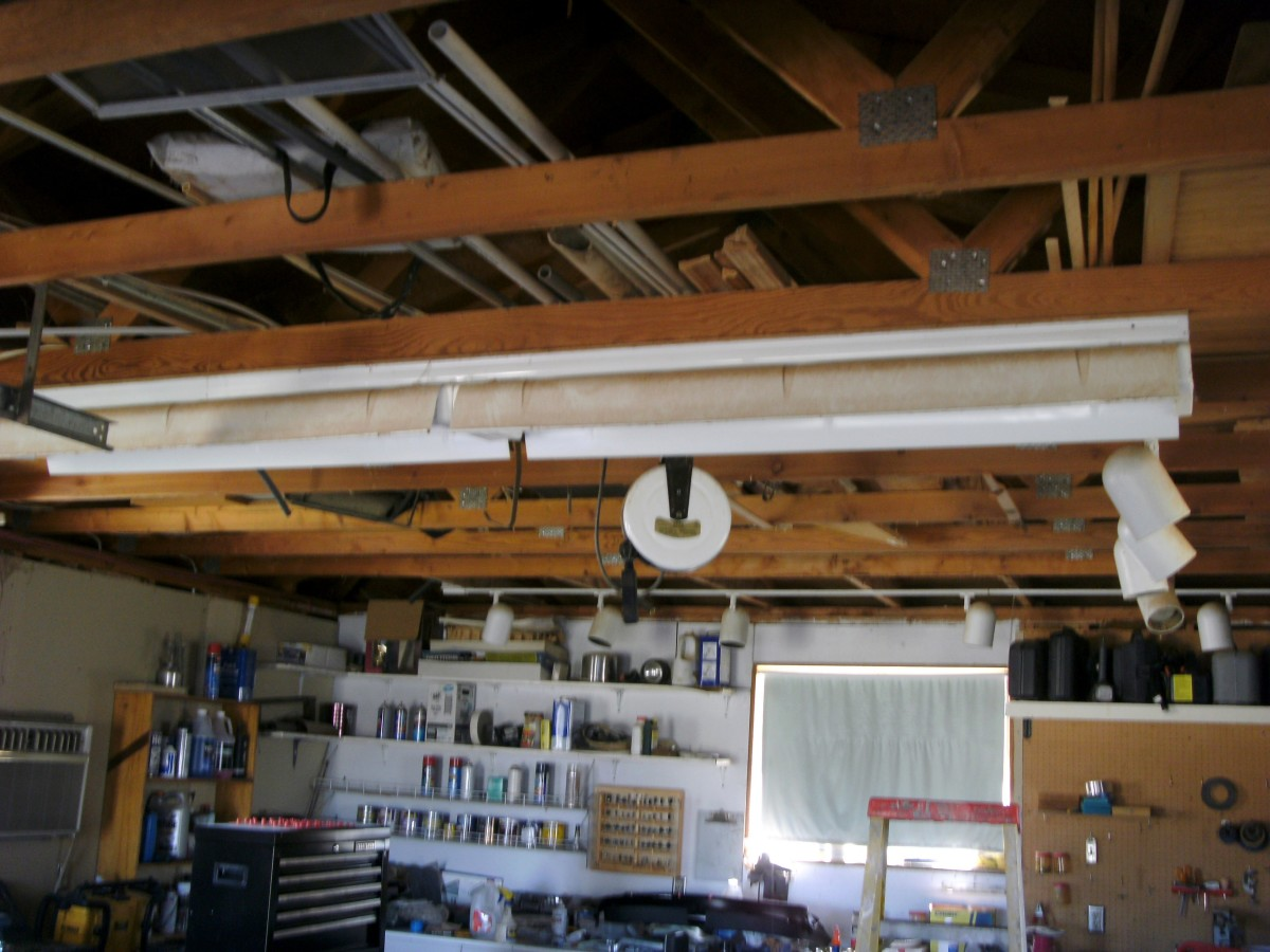 A high quality fixture being used as a shop light.  It has 6 lamps and two ballasts, both on one end of the 8 foot fixture.