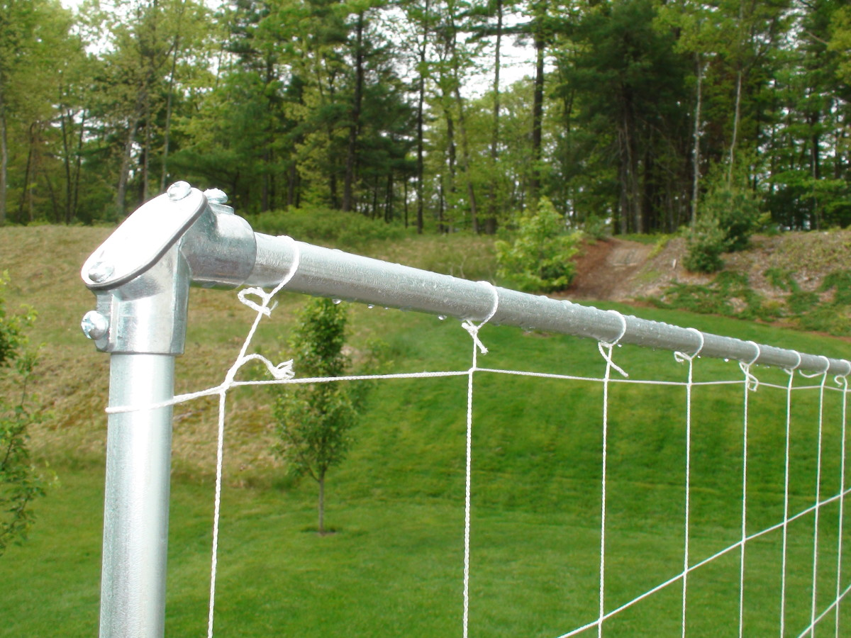 Electrical conduit elbow connector and tied nylon trellis netting.