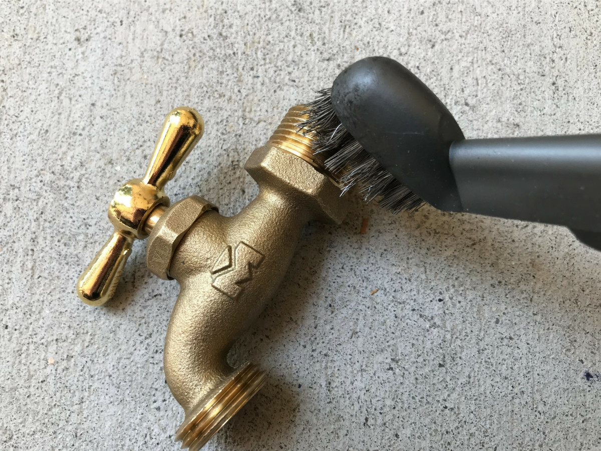 Use a brass or nylon brush rather than a steel brush to avoid scoring and damaging the threads.