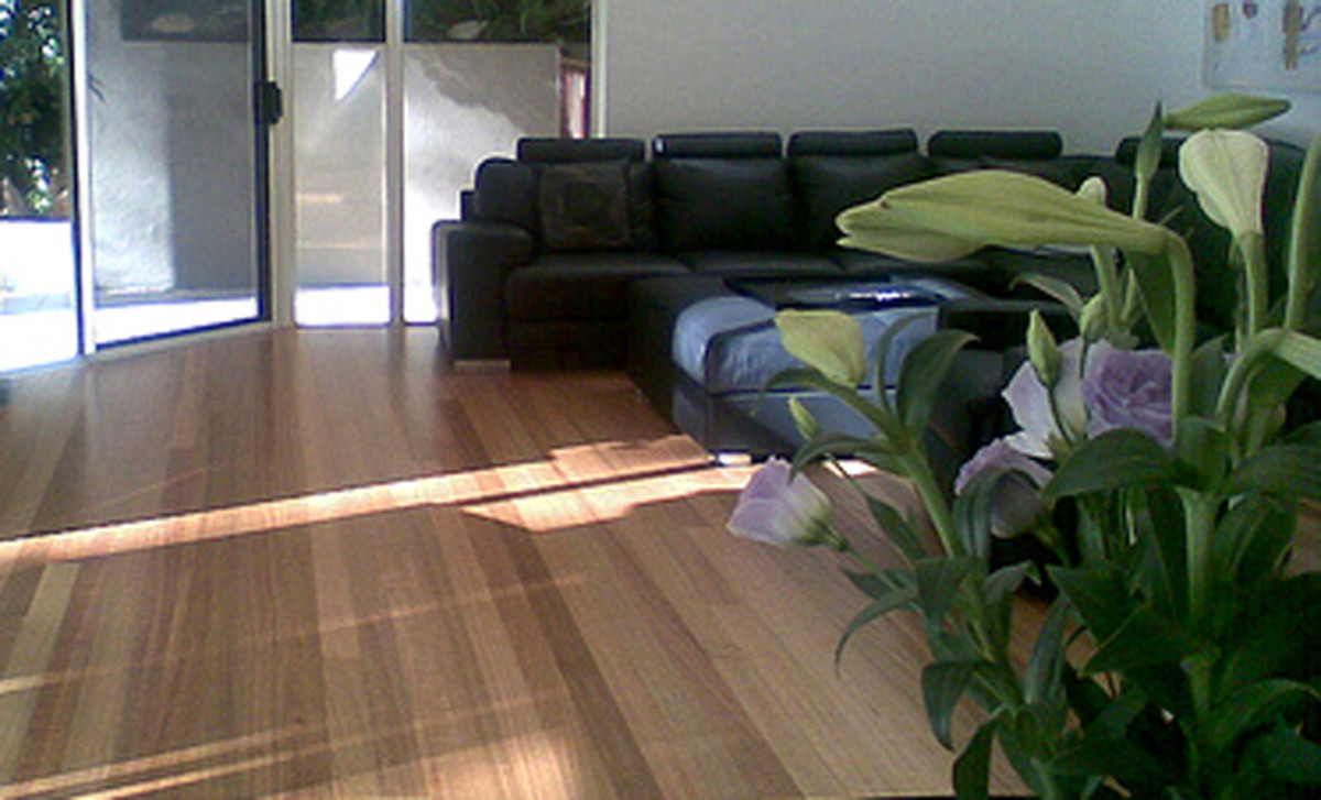 Choose wood laminate or vinyl cork over wood floors for sheer durability.