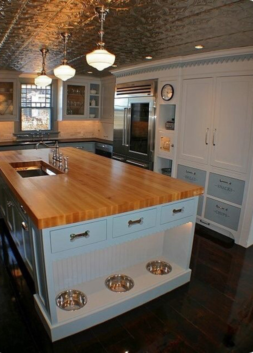 Design an integrated feeding station in the kitchen.