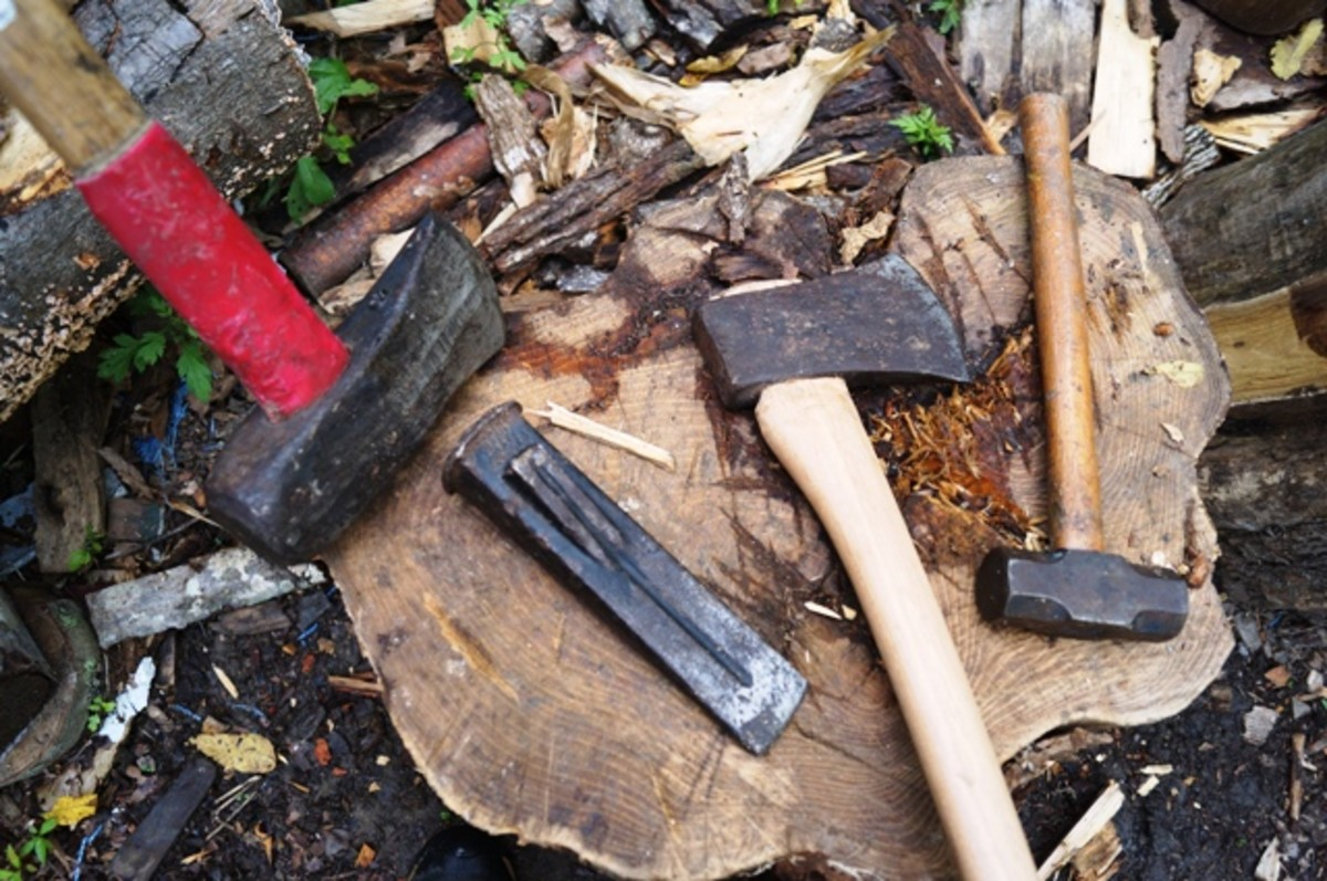 The four main tools I like to use in wood cutting: (from left to right) splitting maul, wedge, ax, and hammer.