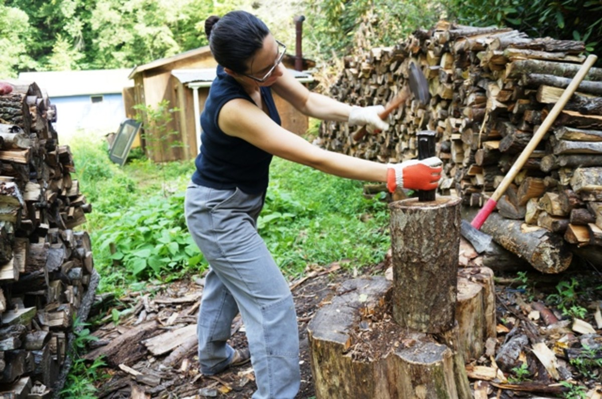 I use the hammer and wedge to get a bigger log (or a knotty one) started.  Then I'll use the splitting maul on the wedge.