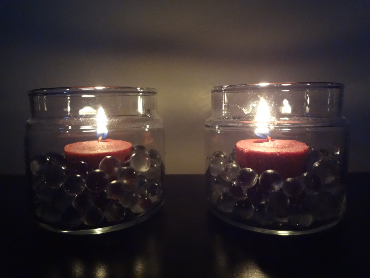 Red candles in a jar with clear water beads.