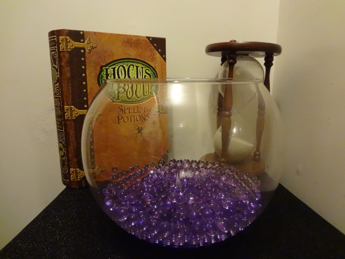 Halloween inspiration - water beads in a bowl with spooky props.