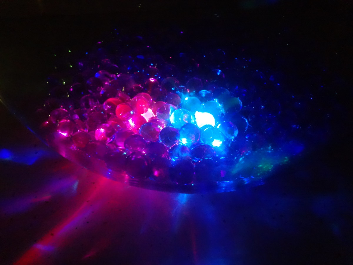 Water beads lit with submersible LED lights.