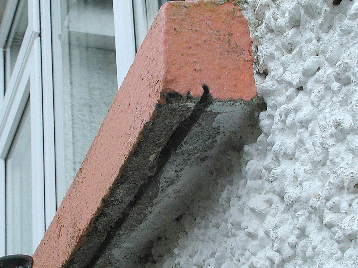 Slot on the underside of a windowsill (cill). This prevents water from running back against the wall and should be clear of cement or other debris