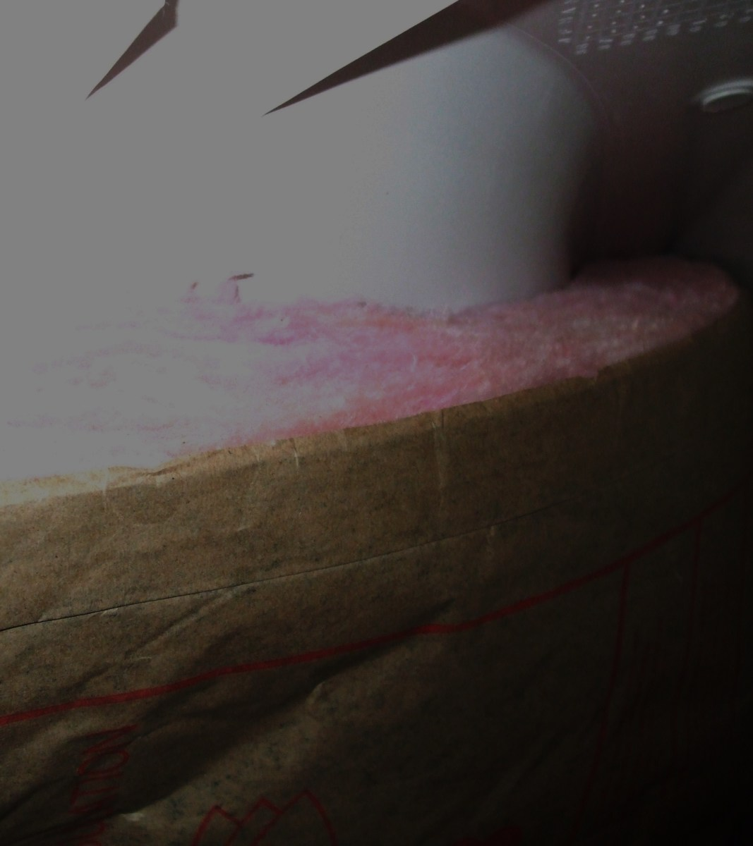 Another view of  roll insulation around a bathtub end.