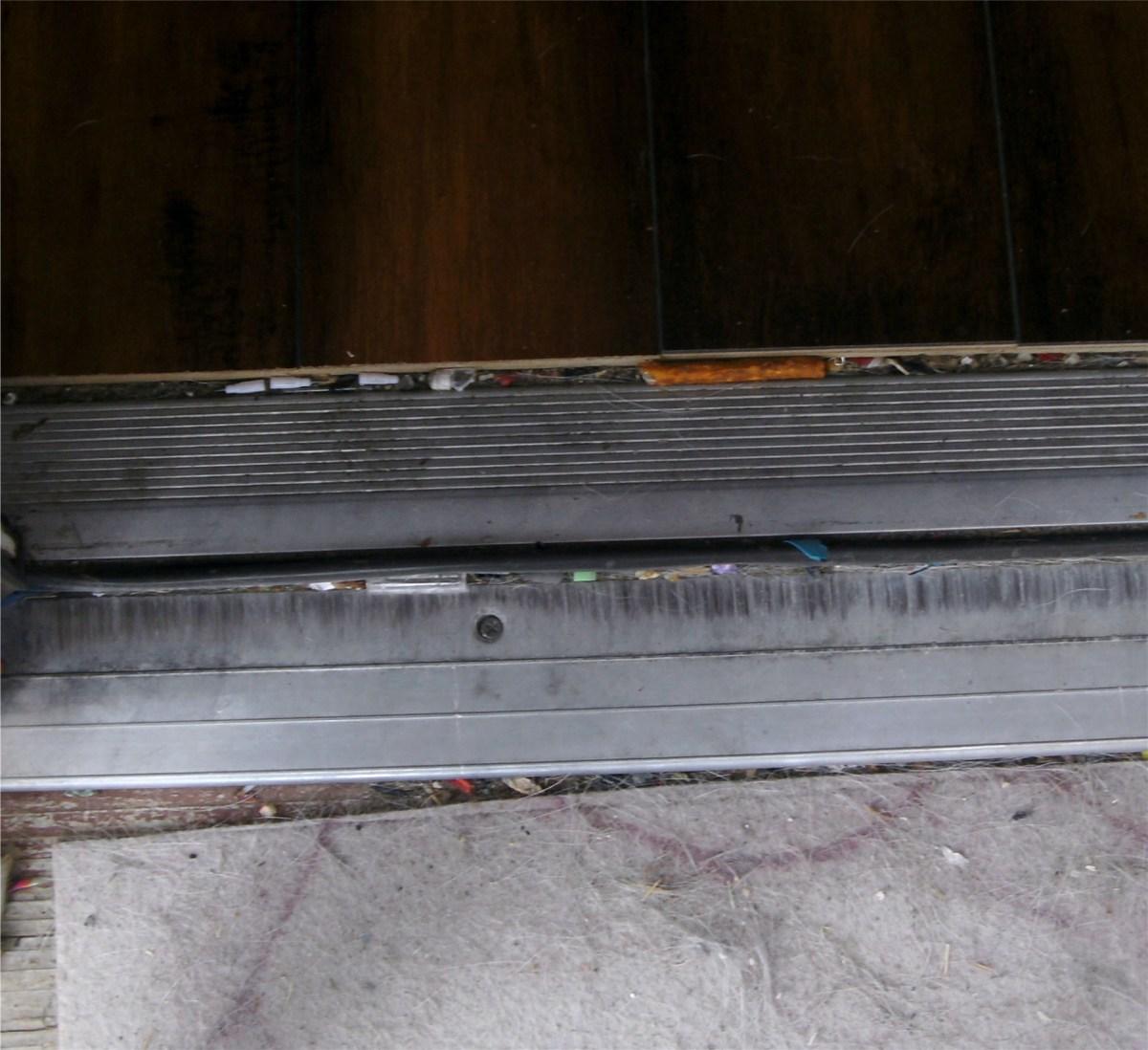 Door threshold; one of the fastening screws is shown.