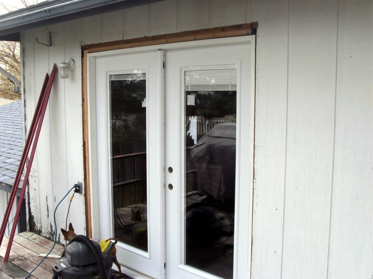 The new door is installed, still needing molding and lockset.