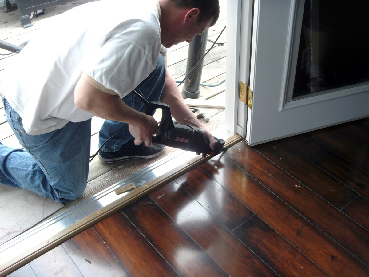 The hardwood floor needed to be slightly trimmed.  Such tasks are not unusual; be prepared for a little custom work.