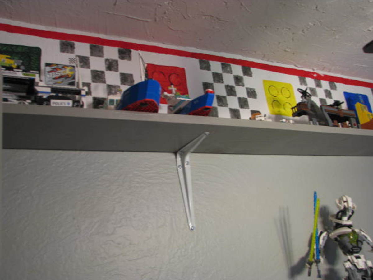 Lego border with added shelves for displaying Legos.