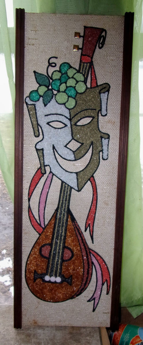 """This is a 1960s vintage mid-century modern pebble or gravel art. Comedy mask with a lute, 24"""" x 8 1/2"""" in wooden frame."""