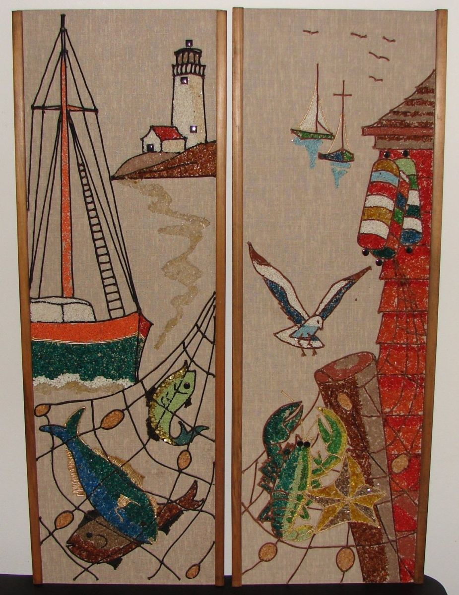 Two lovely gravel wall pieces adorned with a seascape, coastline, ocean life, lighthouse, and boats. Each measures 36 inches tall x 12 inches wide and has wood trim.