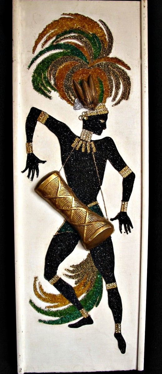 """Early 1960s mid-century modern gravel Art native dancer with drum. Incorporates real feathers and jewels Drum is high relief. 36.5"""" x 13"""""""