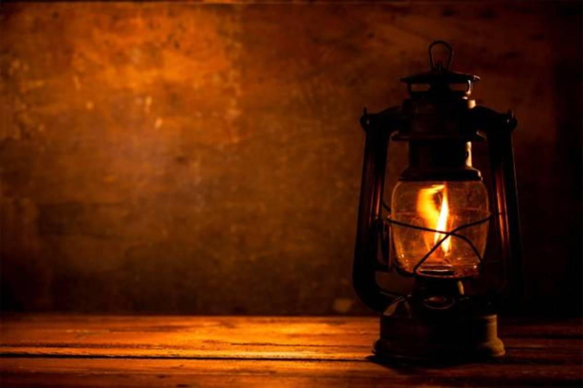 The warm ambiance of a burning oil lamp speaks of an age gone by.