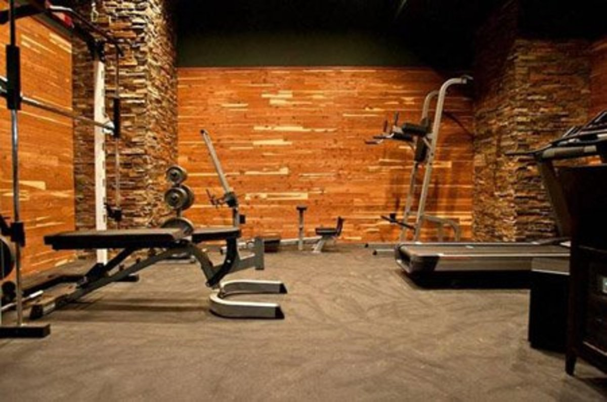 Rustic home gym with wood and stone walls