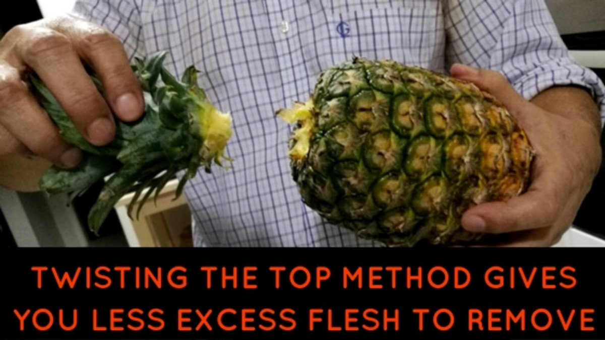 Twisting the pineapple top method gives you less excess flesh to remove